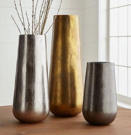 three metal vases